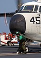 US Navy 050920-N-0535P-187 An Aviation Boatswain's Mate assigned to the Air Department, V-2 Division, completes final checks prior to the launch of a C-2A Greyhound.jpg