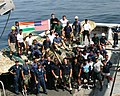 US Navy 050923-N-6114T-002 Crew members aboard the rescue and salvage ship USS Safeguard (ARS 50) gather around a recovered Indian Seahawk jet salvaged by a joint U.S. and Indian dive team.jpg
