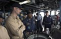 US Navy 060520-N-9851B-014 Commander, Destroyer Squadron One (DESRON-1) Capt. Al Collins, center, confers with amphibious dock landing ship USS Tortuga (LSD 46) commanding officer Cmdr. Michael T. Talaga, left.jpg