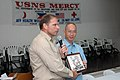 US Navy 060602-N-1577S-074 Navy Capt. Joseph Moore presents Romeo Ong, chief of hospital, with a plaque.jpg