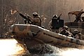US Navy 070123-N-5758H-334 Sailors assigned to Riverine Squadron One (RIVRON-1), based at Naval Amphibious Base Little Creek, train aboard Small Unit River Craft (SURC), during a unit-level training exercise.jpg