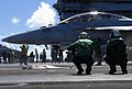US Navy 070808-N-0890S-005 Sailors standby on the foul line while an F-A-18F Super Hornet, assigned to the.jpg