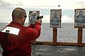 US Navy 070816-N-8119R-063 Lt. Michael Bornstein fires a 9mm during a live fire exercise aboard nuclear-powered aircraft carrier USS Nimitz (CVN 68).jpg