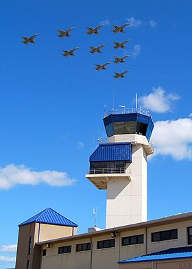"US Navy 070930-N-4469F-015 Aircraft from the ""Sunliners"" of Strike Fighter Squadron (VFA) 87 perform a squadron flyby over the control tower at Naval Air Station Oceana before reuniting with their families.jpg"
