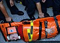 US Navy 071210-N-0924R-022 Aviation Ordnanceman Airman Joseph Rissi acts as a simulated patient during stretcher bearer training as a part of USS Nassau Strike Group's (NASSG) composite unit training exercise.jpg