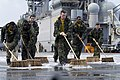 US Navy 080214-N-4010S-057 Sailors aboard the forward-deployed amphibious assault ship USS Essex (LHD 2) scrub the flight deck between flight operations to remove debris that can cause damage to aircraft engines.jpg
