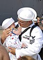 US Navy 080818-N-2838W-182 Sonar Technician 1st Class William Cummings reunites with his daughter.jpg