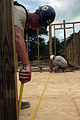 US Navy 080831-N-3595W-126 Air Force Staff Sergeant John Kimble helps to build a school house.jpg
