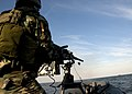 US Navy 080903-N-4500G-323 A Special Warfare Combatant-craft Crewman fires a .50-caliber machine gun.jpg