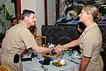 US Navy 090511-N-3666S-006 Vice Adm. Michael Vitale, commander, Naval Installations Command, meets with Gas Turbine System Technician (Mechanical) 3rd Class Alahnna Taylor, assigned to Naval Station Pearl Harbor, during lunch a.jpg