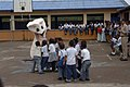 US Navy 090610-F-1333S-024 Colombian children gather around the USNS Comfort dental mascot as the ship's dental team and the U.S. Air Force South Band bring music and dental health care education to Cuidadela Mixtra Escuela.jpg