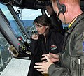 US Navy 090622-N-2475A-027 Alaska Gov. Sarah Palin, left, listens as Air Boss Capt. Gordon Smith, from Mercer Island, Wash., explains the responsibilities of coordinating aircraft movement on the flight deck.jpg