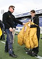 US Navy 091030-N-5366K-021 Chief Special Warfare Boat Operator (SWCC) J.C. Ledbetter, assigned to the U.S. Navy Parachute Team, the Leap Frogs, shows a midshipman from the U.S. Naval Academy's parachute team how to pack.jpg
