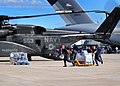 US Navy 100116-N-4774B-827 Sailors load bottles of fresh water into an MH-53E from Helicopter Mine Countermeasures Squadron (HM) 14 that will be delivered to earthquake survivors.jpg