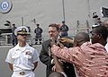 US Navy 100118-N-2468S-002 U.S. Ambassador to the Republic of Congo Alan Eastham, right, and Cmdr. Charles L. Sellers, commanding officer of the guided-missile frigate USS Samuel B. Roberts (FFG 58).jpg