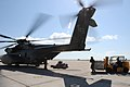US Navy 100122-N-7456N-057 Navy air crewmen load pallets of meals ready-to-eat onto an MH-53E Sea Dragon helicopter bound for Haiti at the airfield at Naval Station Guantanamo Bay.jpg
