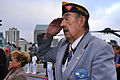 US Navy 100605-N-3038W-077 Bill Landry salutes while the national anthem plays during a Battle of Midway commemoration ceremony aboard the USS Midway (CV 41) Museum.jpg