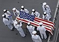 US Navy 100610-N-5358L-049 ailors assigned to the amphibious assault ship USS Boxer (LHD 4) serve as pallbearers and commit the ashes of a fallen shipmate to sea.jpg