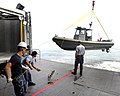 US Navy 100616-N-9643W-083 Sailors and contracted mariners aboard High Speed Vessel Swift (HSV 2) launch a small boat during a Southern Partnership Station 2010 training exercise.jpg