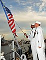 US Navy 100831-N-5812W-002 oatswain's Mate 3rd Class Taylor Branch, left, and Boatswain's Mate 1st Class James Wallen haul down the American flag for the last time during the decommissioning ceremony of the guided-missile friga.jpg