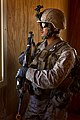 US Navy 100906-M-7045P-016 Hospital Corpsman Albert Amayarivera provides security from the window of a cleared building during a foot patrol throug.jpg