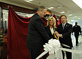 US Navy 100928-N-4790M-085 The Under Secretary of the Navy Robert O. Work, left, Kenneth Fisher and his wife Tammy cut the ribbon during the unveil.jpg