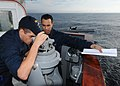 US Navy 110204-N-9793B-039 Quartermaster Seaman Michael E. Martinez, right, and Logistics Specialist Seaman Kevin L. Benson review the operation of.jpg