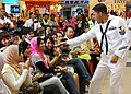 US Navy 110610-N-VP123-137 Musician 1st Class Christopher Sams enlists the help of the audience for a Michael Jackson song during a concert at Kuan.jpg
