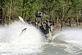 US Navy 110611-N-MR305-059 Carp fly out of the water as Sailors assigned to Riverine Squadron (RIVRON) 3 conduct category IV live-fire training on.jpg