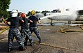 US Navy 110720-N-ZR940-001 Sailors aboard USS Harry S. Truman (CVN 75) spray down a training E-2C Hawkeye during routine aviation damage control tr.jpg