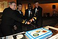 US Navy 111006-N-TO330-768 Rear Adm. Sean Buck, right, commander of Fleet Air Forward, Command Master Chief Anthony Johnson, this year's oldest Sai.jpg