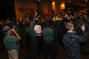 US Navy 120101-N-RG587-108 Sailors assigned to the Nimitz-class aircraft carrier USS Carl Vinson (CVN 70) celebrate in the hangar bay during a mora.jpg