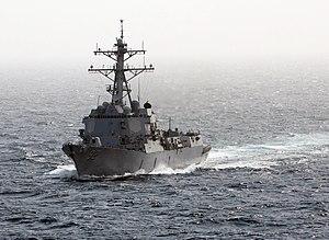 US Navy 120213-N-DR144-128 The Arleigh Burke-class guided-missile destroyer USS Momsen (DDG 92) arrives alongside the Nimitz-class aircraft carrier.jpg