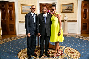Uhuru Kenyatta - U.S. President Barack Obama and First Lady Michelle Obama greet President Uhuru Kenyatta in the Blue Room during a U.S.-Africa Leaders Summit dinner at the White House, 5 August 2014.
