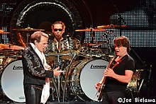 Roth and the Van Halen brothers performing