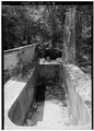 VIEW OF CISTERN AND SMOKE STACK - Estate Cinnamon Bay, Sugar Mill Ruins, Cinnamon Bay, Windberg, St. John, VI HAER VI,2-MABA,3-8.tif