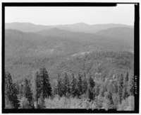 VIEW SOUTH FROM THE SOUTH CATWALK; PILOT PEAK IS THE TALLEST IN THE BACKGROUND RANGE - North Mountain Lookout, Stanislaus National Forest, Groveland, Tuolumne County, CA HABS CAL,55-GROLA.V,2-11.tif