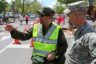 Virginia Defense Force - Brig. Gen. Timothy P. Williams, the Adjutant General of Virginia speaks to a member of the Virginia Defense Force during the 2015 Apple Blossom Festival in Winchester, Virginia.