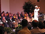 Volunteer speaking at a faith based memorial service for Hurricane Charley victims.jpg