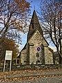 Voss Church (Voss kirke-kyrkje, Vangskyrkja) 13th-c stone church, Voss, Norway 2016-10-25 -01- front, infomation sign.jpg