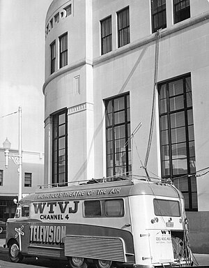 Wometco Enterprises - Mobile truck for the Wometco-owned WTVJ in front of the Miami Herald building in downtown Miami, circa 1950.