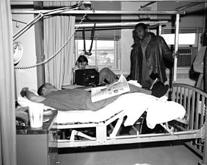 Fitzsimons Army Medical Center - Professional football player Wendell Hayes visits patients during the Vietnam War.