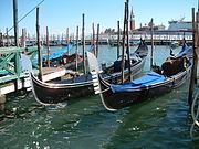 Several gondolas docked in Venice
