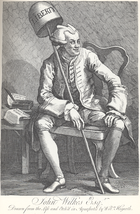 """John Wilkes, with two editions of his """"North Briton"""", including Number 45 which criticized the King's speech and the cider tax."""
