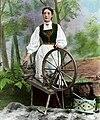 Woman and spinning wheel (Fylkesarkivet i Sogn og Fjordane).jpg