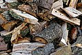 Wood stack at The Plough in Lower Beeding, West Sussex, England.jpg