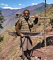 Woodcutter with his tools near Kanoor, Kashmir.JPG