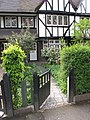 Wooden gate, privet hedge and half-timbered house - geograph.org.uk - 1840068.jpg