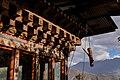Wooden phallus at a door in bhutan.jpg