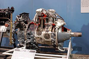 Wright R-3350 Duplex-Cyclone - A Wright R-3350 radial engine, showing, R to L, propeller shaft, reduction gearcase, magneto (silver) with wiring, two cylinders (rear with connecting rod), impellor casing (and induction pipe outlets) and injection carburetor (black); separate accessory gearbox at extreme left